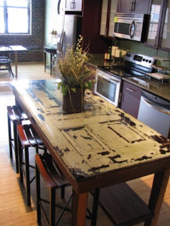 A KITCHEN ISLAND MADE FROM AN OLD DOOR