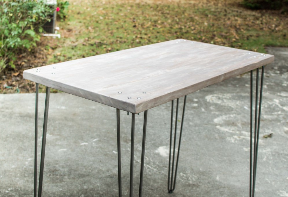 A STANDING DESK WITH WOOD TOP METAL LEGS